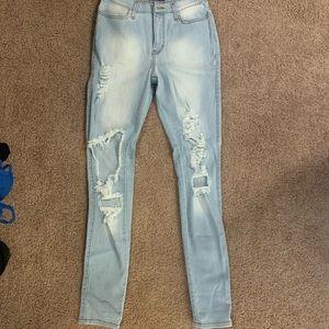 FashionNova light washed ripped jeans